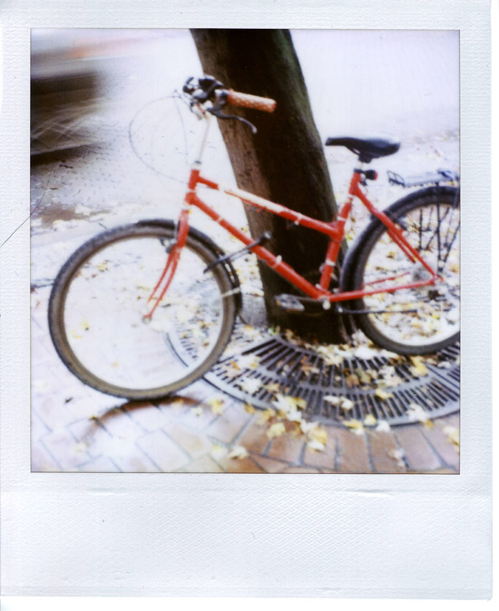 Polaroid of a Random Bike on water street