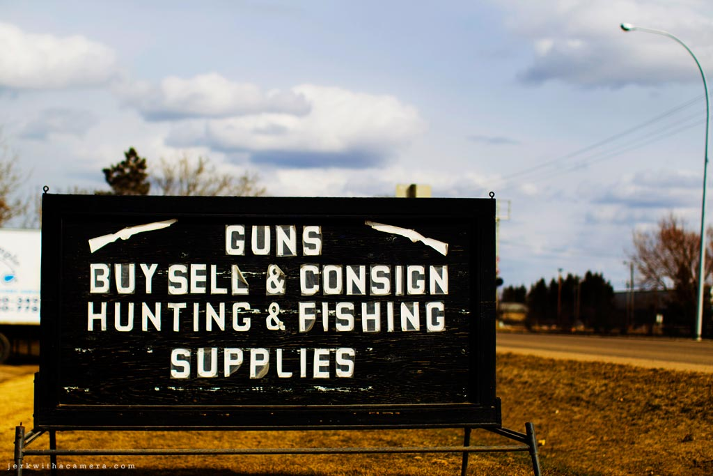 Alberta Trek - A gun store sign