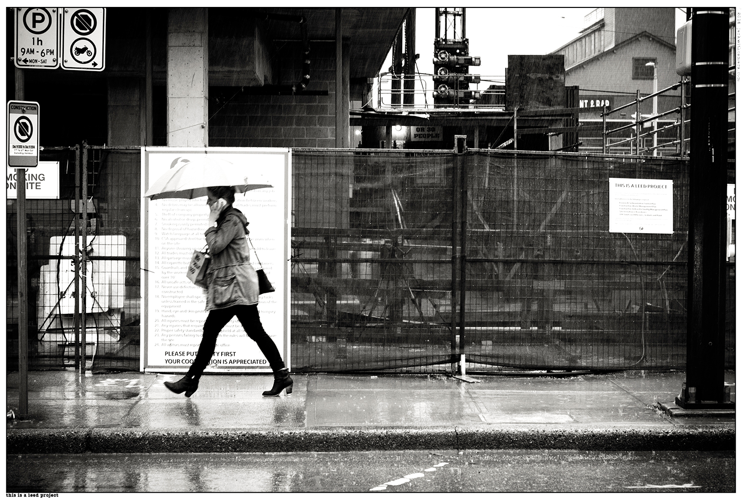 Picking On Complete Strangers - Nikon D610 - Olympic village Walking in the rain